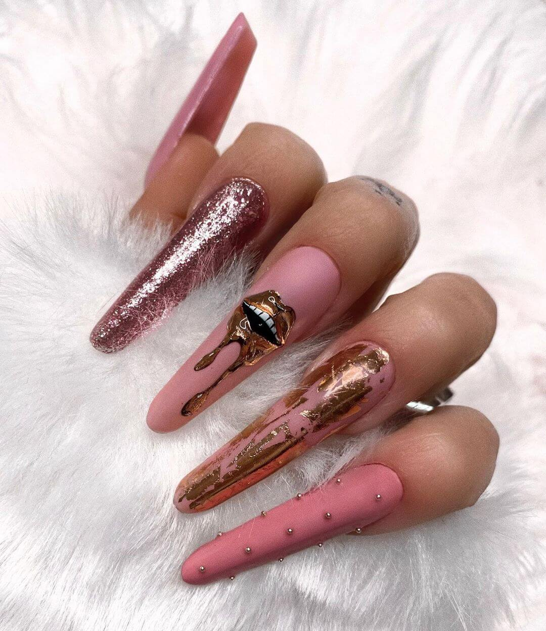 Gold on Pink Nail Art Designs