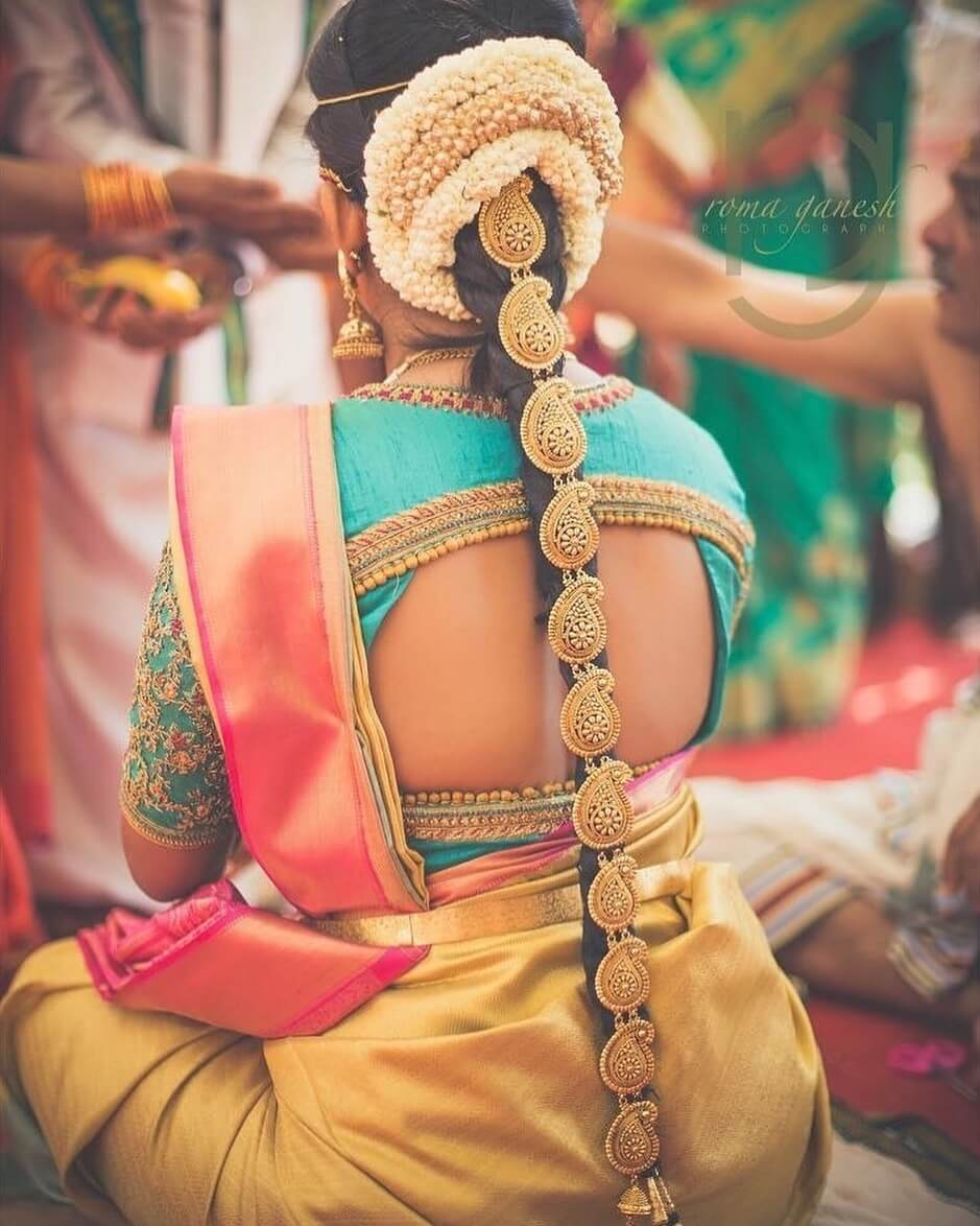 Fancy blouse with sexy cuts South Indian Real Bride Blouse Designs