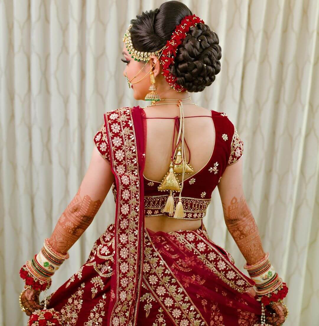 Cascading Voluminous Gujrati Bridal Bun Hairstyles