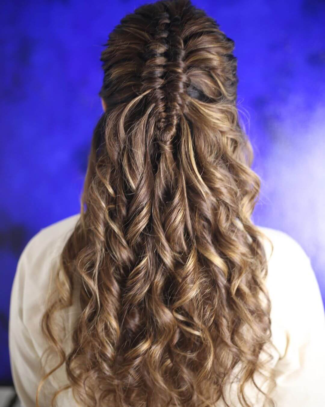 Half Braided Wavy Look Hairstyles with Gown for Indian Wedding