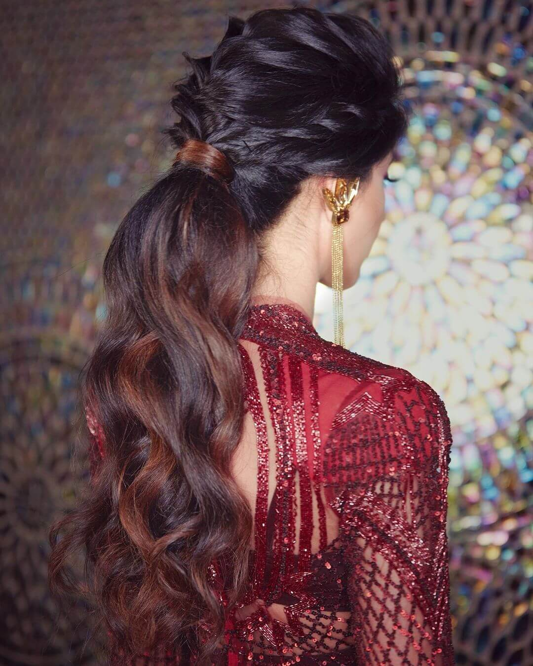 Textured Braided Ponytail Hairstyles with Gown for Indian Wedding