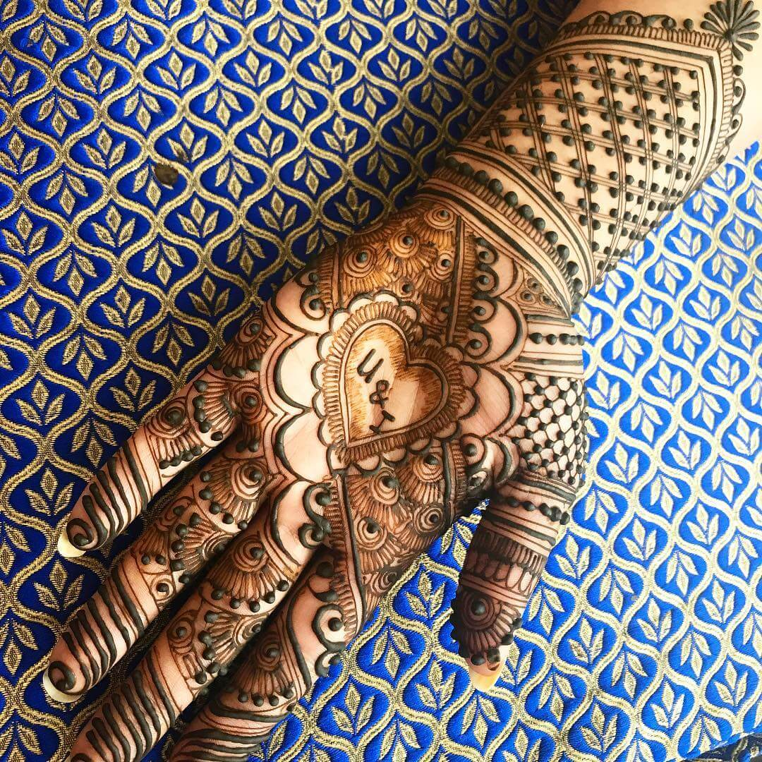 Front Hand heart shaped Mehndi Design For Bride