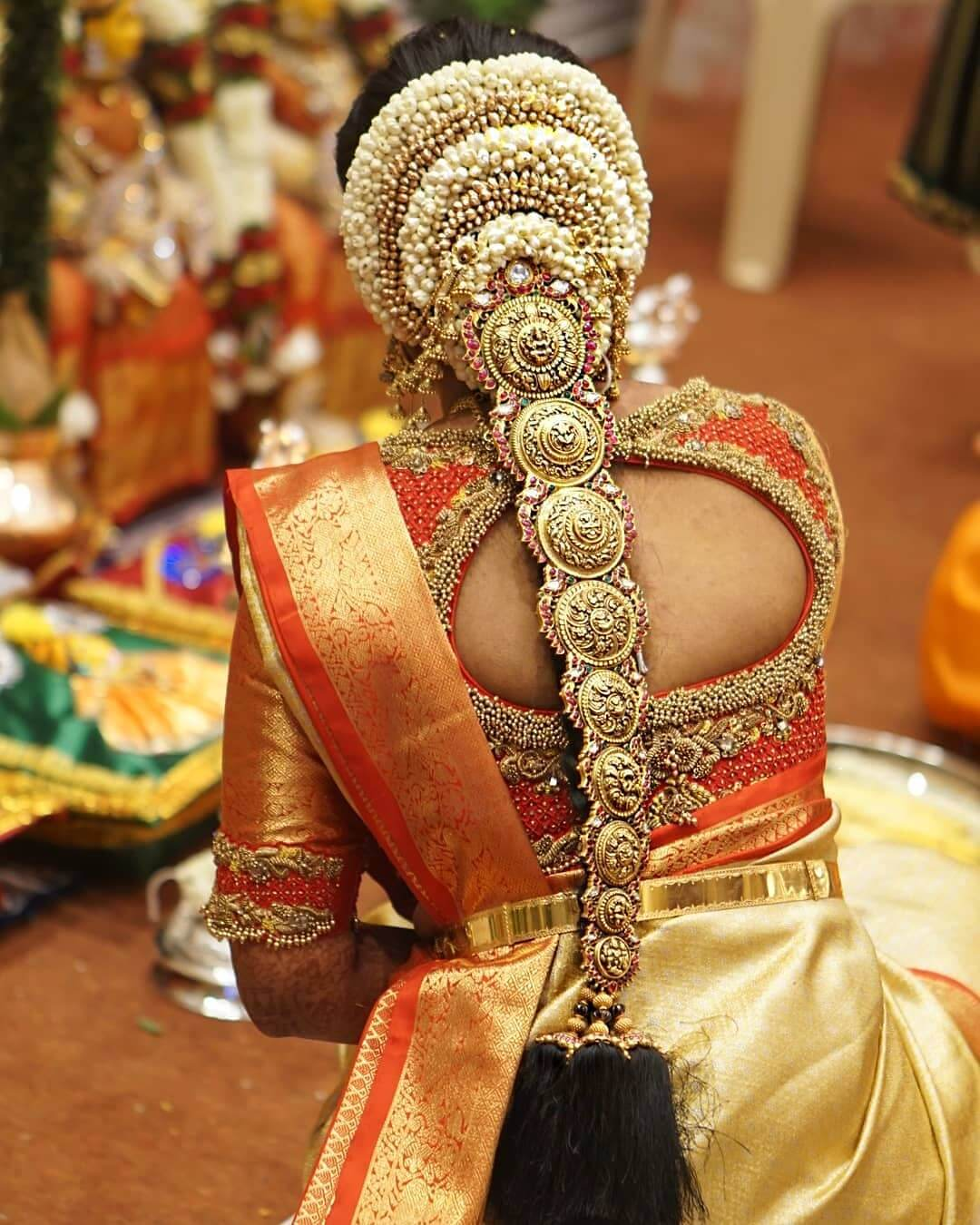 Traditional South Indian Bridal Hairstyle With Heavy Stone For Braid Cover