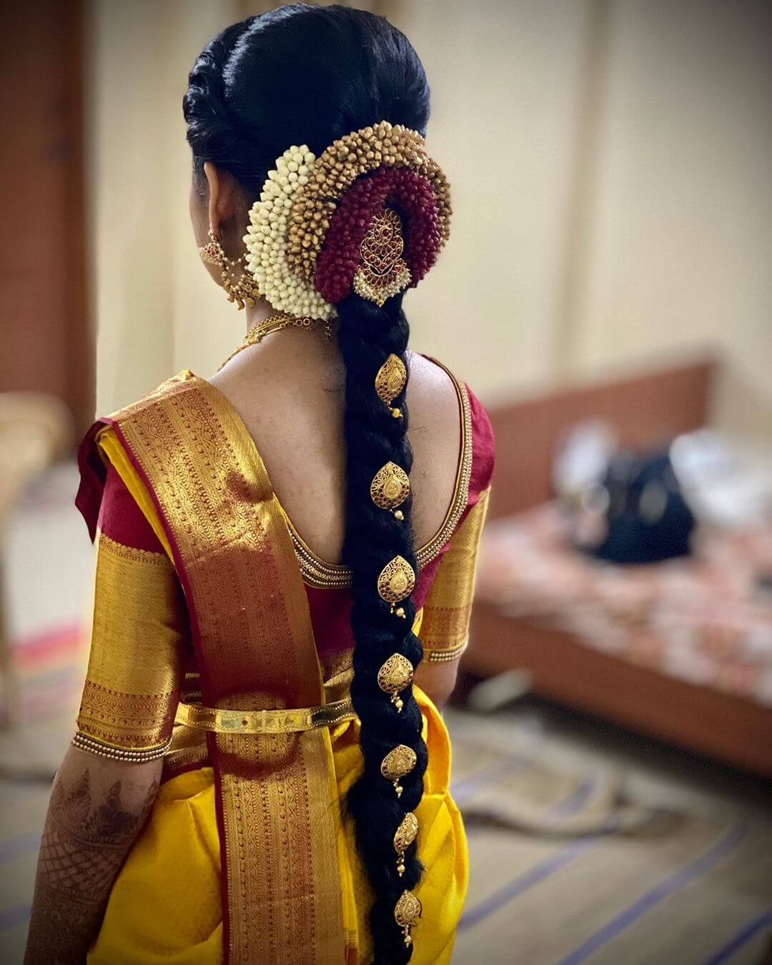 Traditional South Indian Bridal Hairstyle With Different Garland And Stone Jewel