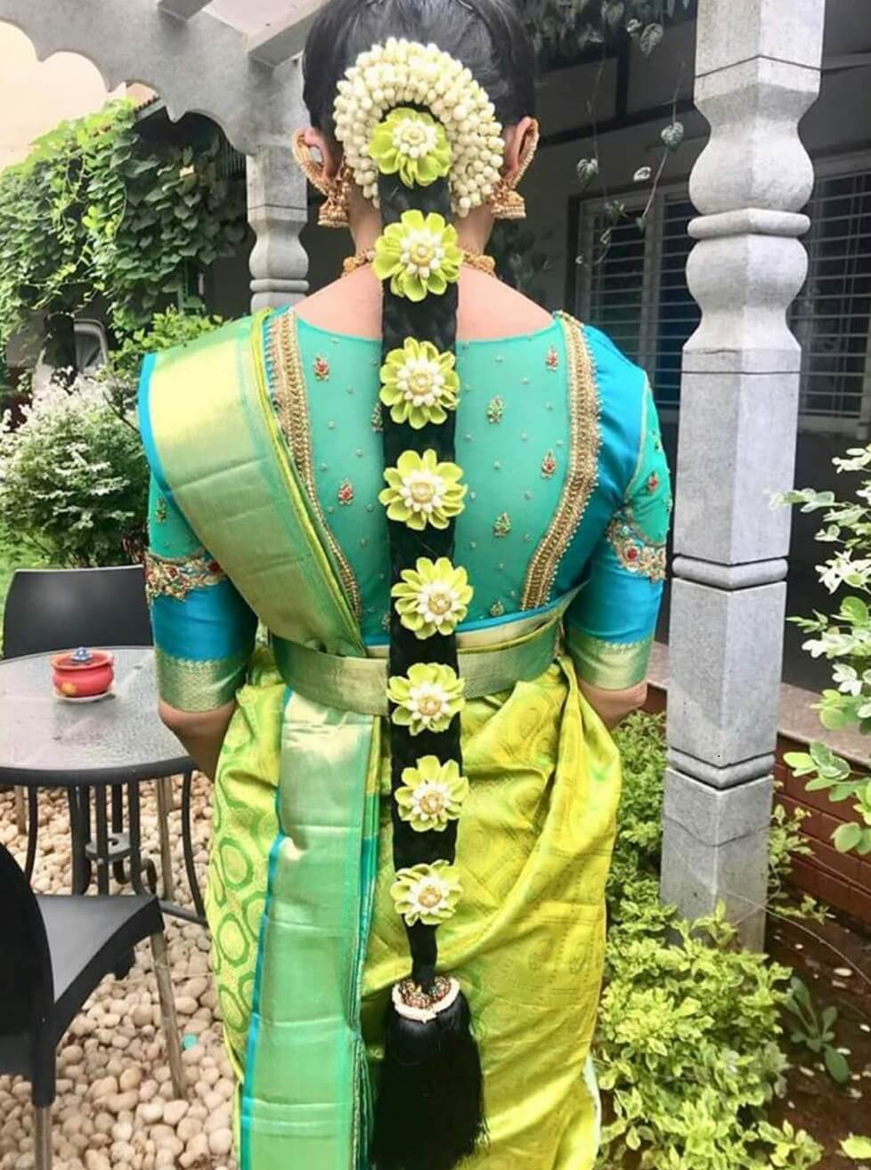 Traditional South Indian Bridal Hairstyle With Green Flower And Garland Cover
