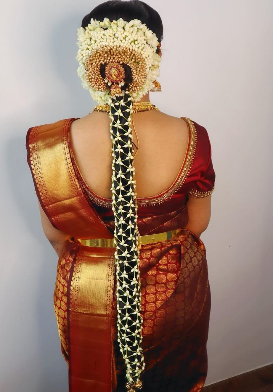 Traditional South Indian Bridal Hairstyle With Net Vein And Stone Cover