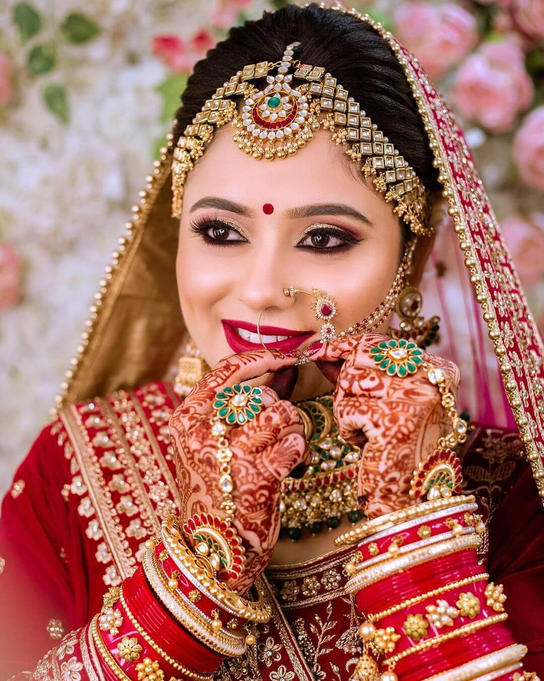 Red lehenga with gold embellishments bridal Look