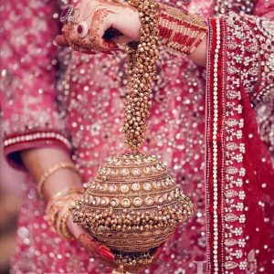 This embellished potli bag has all our hearts and we might choose this as our pick for the wedding day.