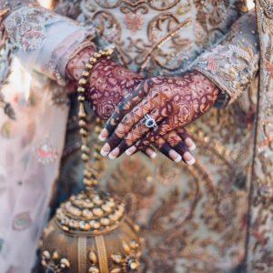 Wonderful designs carved on a golden potli is always on trend