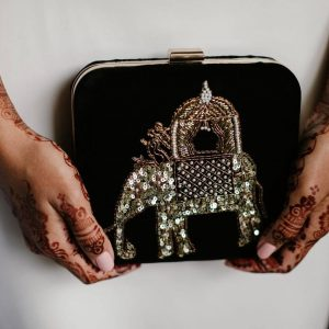The perfect Indian bride wishes to get carried on a palanquin - Designer Bridal Handbags - Clutches, Potli & More