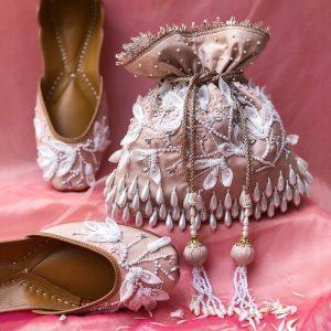 Featuring a floral look to ooze royalty - Designer Bridal Handbags