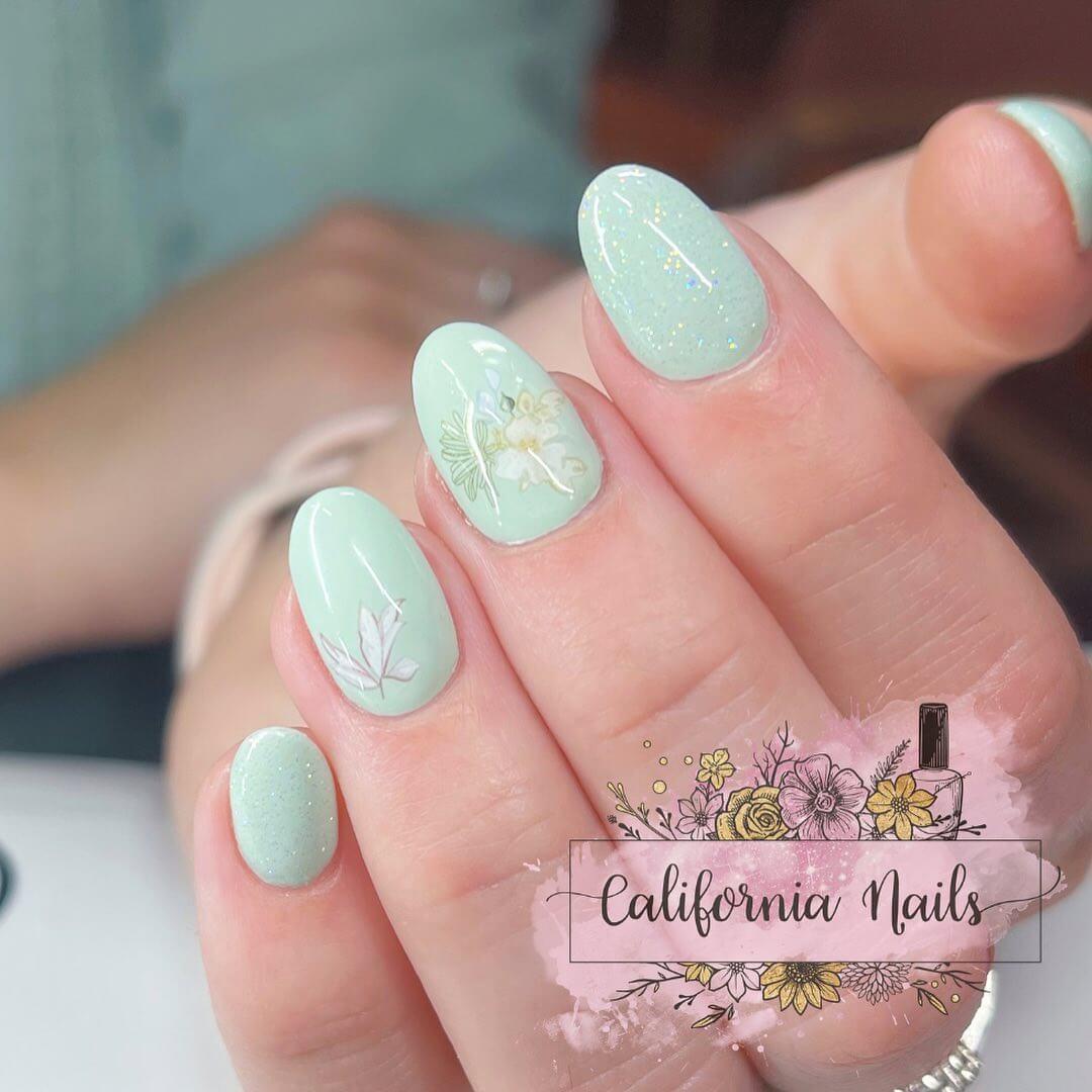 Gel Nail Art Floral Stickers Over Green Gel Nail Art Design